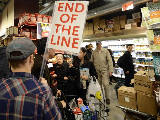 People try to get through the aisles at Whole Foods Market in midtown in New York October 28, 2012 as residents do last minute shopping in preparation for Hurricane Sandy. Pic: AFP
