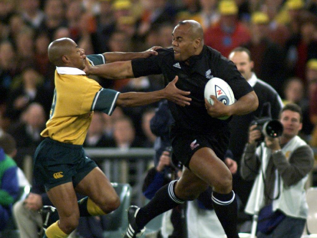 JULY 15, 2000 : Jonah Lomu (ball) tackled by George Gregan during Australia v New Zealand Bledisloe Cup game at Stadium Australia in Homebush, Sydney 15/07/00. Pic Scott Hornby. Rugby Union A/CT