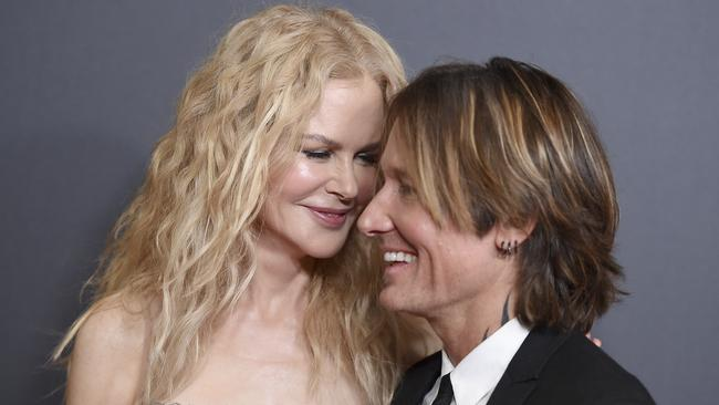 Loved up: Another red carpet with husband Keith Urban. Picture: AP