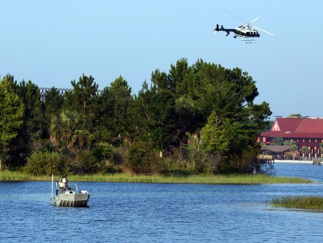 Florida Fish and Wildlife and an Orange County Sheriffs helicopter search for the young boy. Picture: Red Huber/Orlando Sentinel
