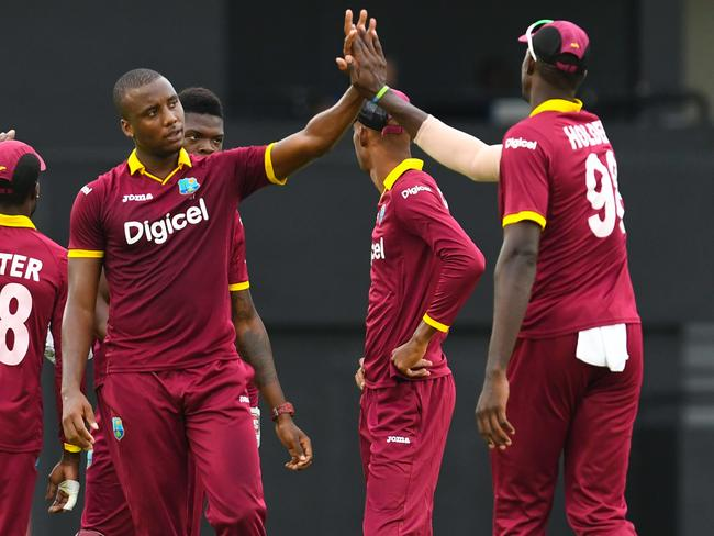 Miguel Cummins of West Indies celebrates the dismissal of Javed Ahmadi of Afghanistan.