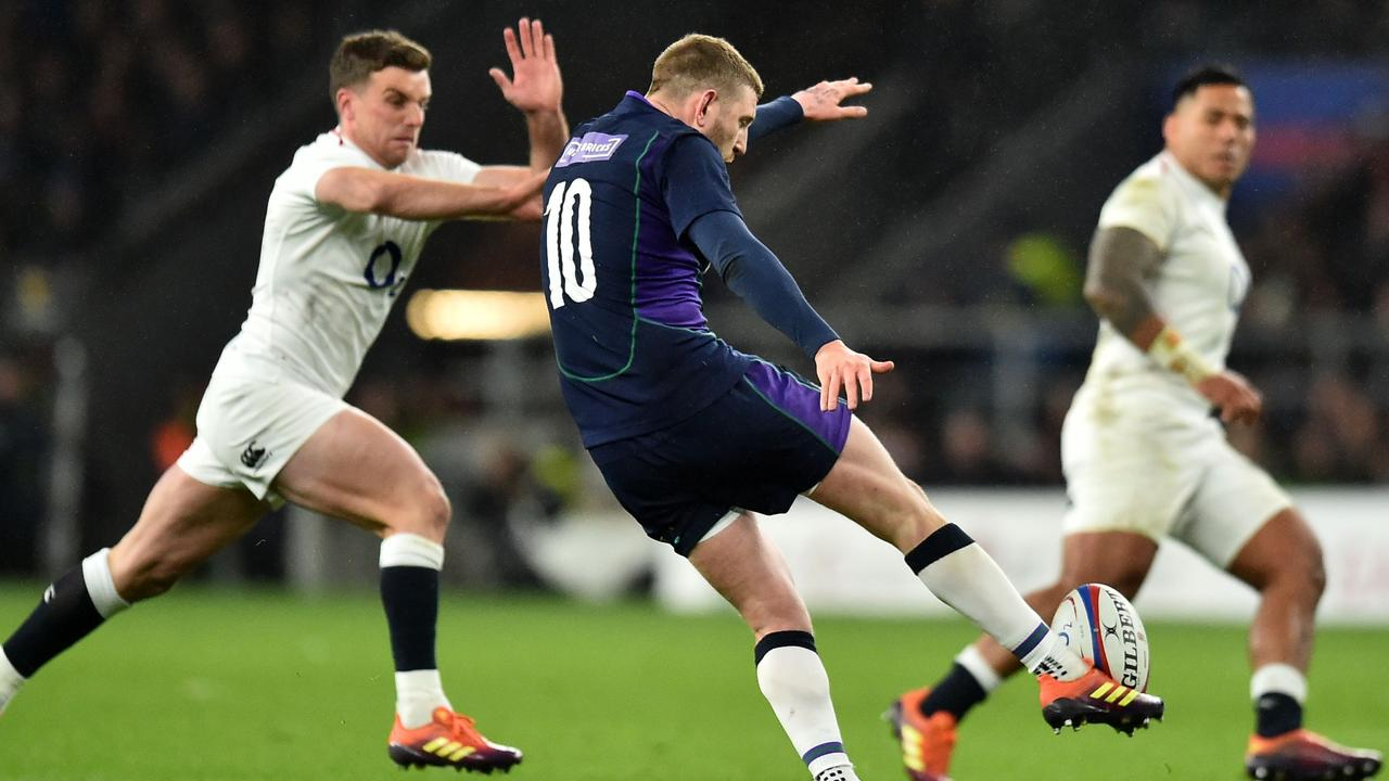 Scotland fly-half Finn Russell kicks the ball up field at Twickenham.