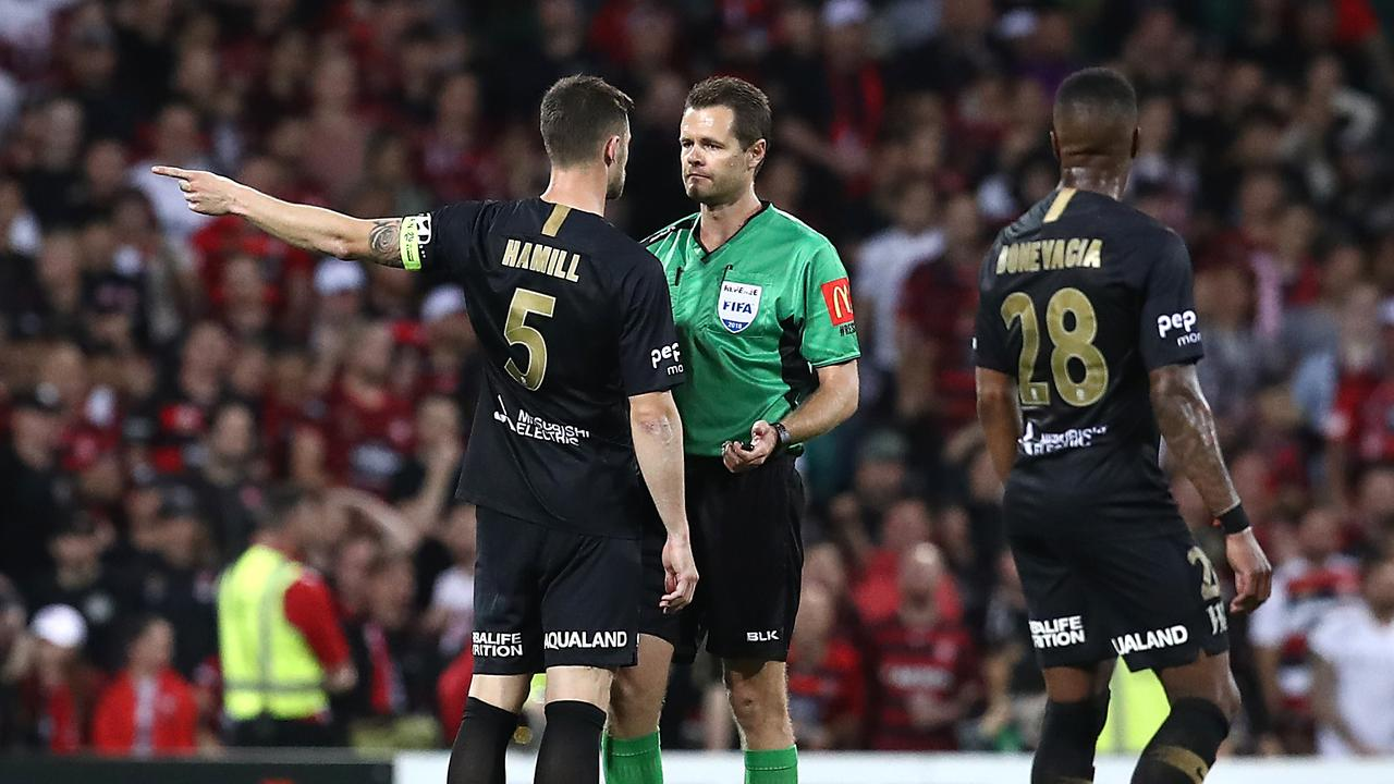 Brendan Hamill remonstrates with the referee after he overturned a VAR goal review.