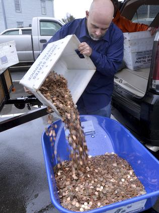 The 300,000 pennies weighed 725 kilograms and took four hours to move.  <i>Picture: David Criggeru</i>