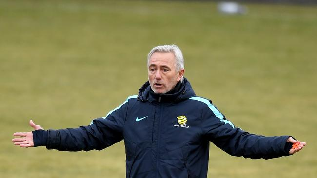The Australian Socceroos Manager Bert van Marwijk gives instructions during a training session