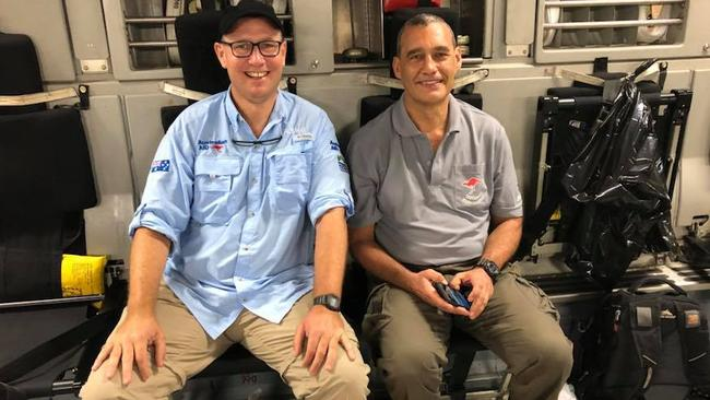 Thailand cave diving hero Dr Richard Harris with dive partner Craig Challen on the way back to Australia after the successful operation. Picture Facebook