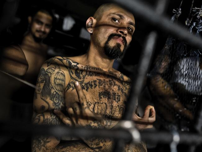 A local leader of MS-13 shows a hand sign that represents his gang in a cell at a detention centre in San Salvador. Picture: Jan Sochor/Getty Images