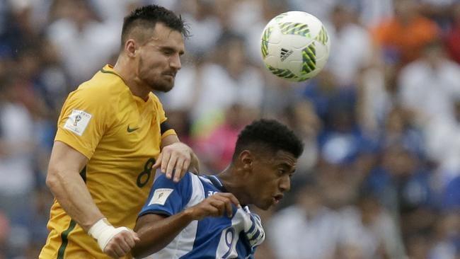 Australia's Daily Wright, left, goes for a header with Honduras' Anthony Lozano