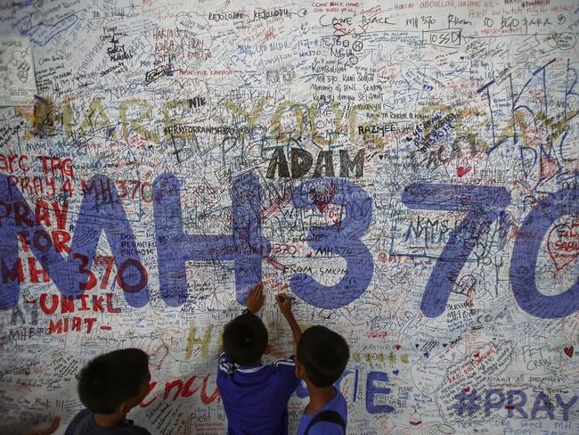Children write messages of hope for passengers of missing Malaysia Airlines Flight MH370 at Kuala Lumpur International Airport in 2014. Picture: Reuters/Samuel Said
