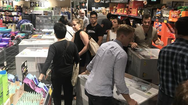 Shoppers hustle in a bid to get their hands on the eight rocking chairs available at the Chatswood store.