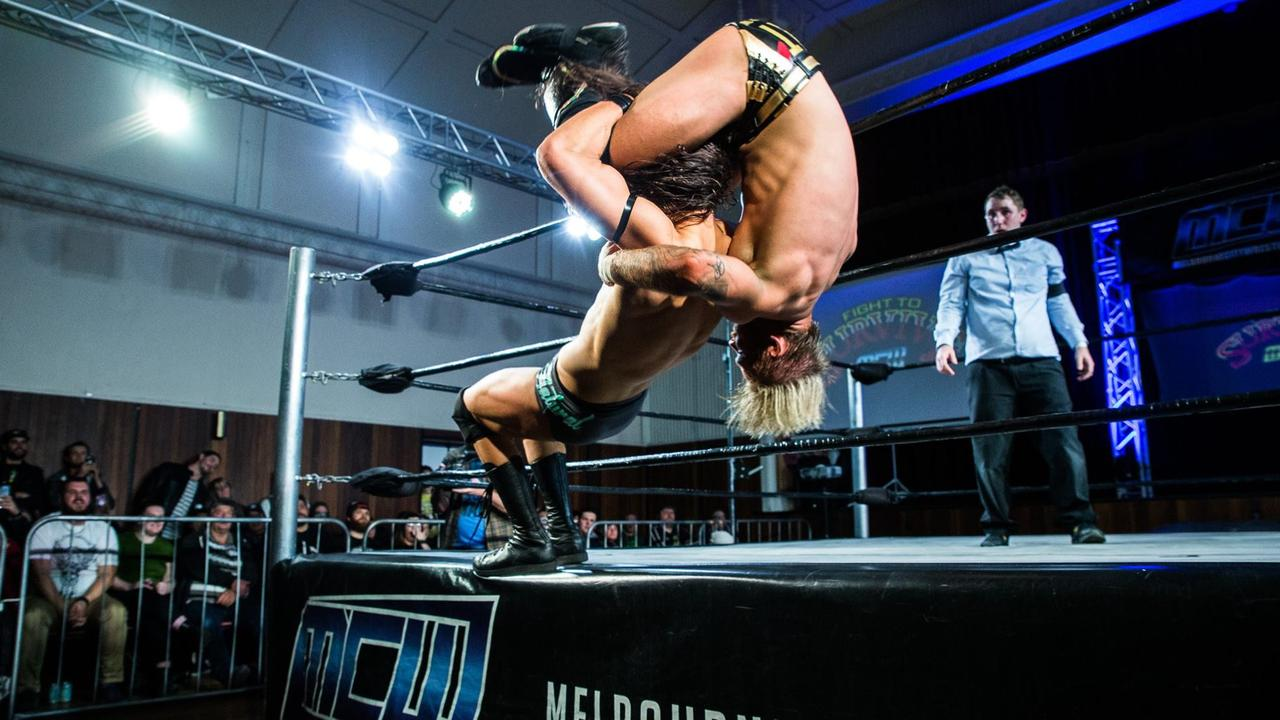 Adam Brooks (upside-down) wrestles Stevie Filip at Melbourne City Wrestling's Fight to Survive show on September 8. Photo via Digital Beard Photography.