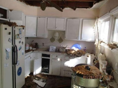 Did the exploding cake blow a hole in the roof and cause the curtains to fall down? Picture: terriblerealestateagentphotos.com