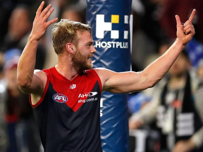 Jack Watts celebrates towards the Collingwood cheer squad.