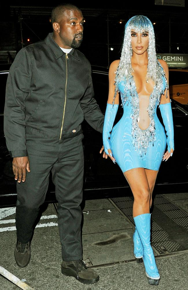 Kim wore a tight blue latex dress to the Met Gala afterparty later that night. Picture: Mega