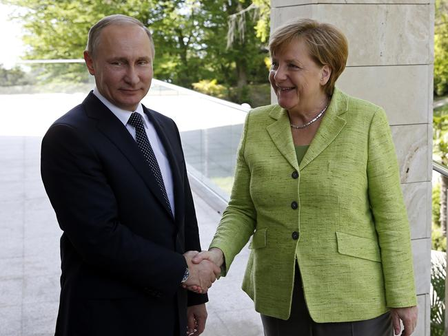 """It's about time ... er, I mean, nice to see you, Mrs Merkel."" *forces smile* Picture: Yuri Kochetkov"