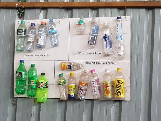 On the wall of the aggregation centre is a story board of bottles which can and cannot be recycled under the strict guidelines for The Body Shop packaging. Picture: Candy Sutton.