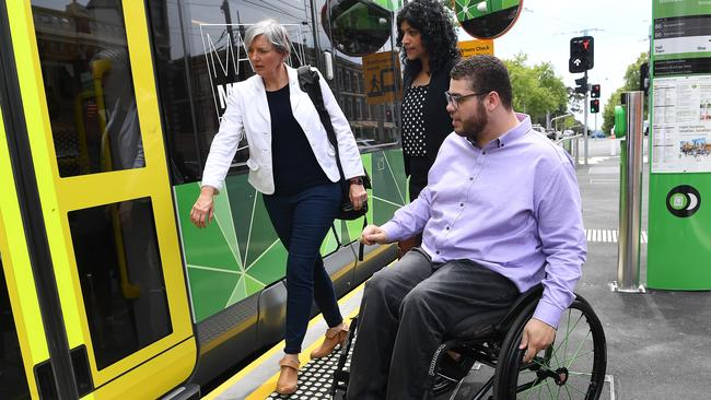 Greens candidate for Richmond, Kathleen Maltzahn (left), Victorian Greens leader Samantha Ratnam, and federal senator Jordon Steele-John board a tram after announcing a promise make trams more accessible. Picture: Julian Smith/AAP