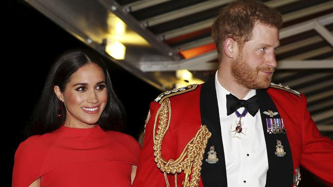 Britain's Prince Harry and Meghan, Duchess of Sussex held hands as they arrived at the Royal Albert Hall in London. Picture: Simon Dawson/Pool via AP.