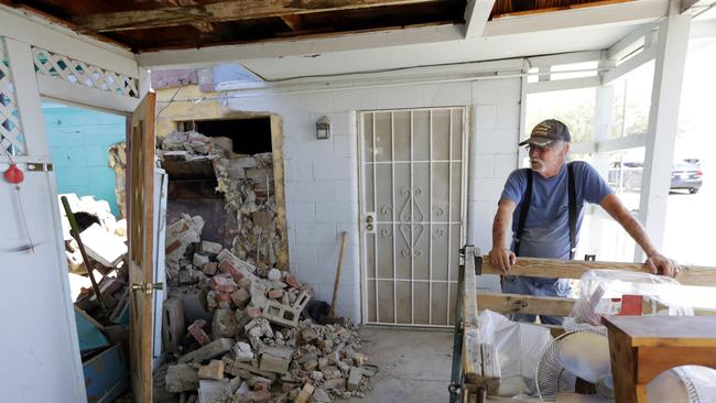 Eugene Johnson looks at the chimney collapsed by an earthquake at his home in Trona, California. Picture: AP/Marcio Jose Sanchez.