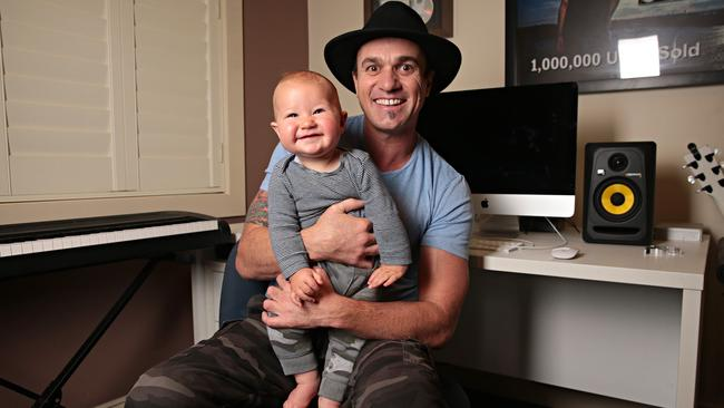 Shannon Noll poses with youngest son Colton. Picture: Adam Yip