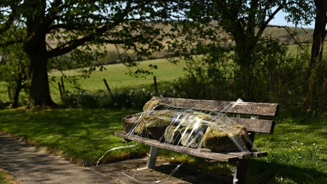 A bench is taped up in the hamlet of Diglea, northern England on April 17.