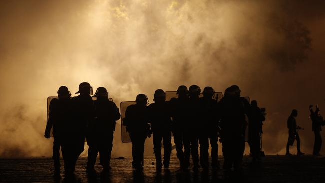 Riot police officers take position near the Arc de Triomphe. Picture: AP
