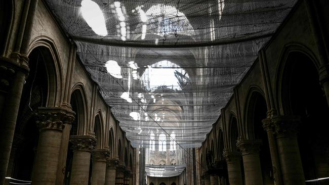 A protective net has been placed in the Notre Dame de Paris Cathedral during preliminary work. Picture: Philippe Lopez/POOL/AFP