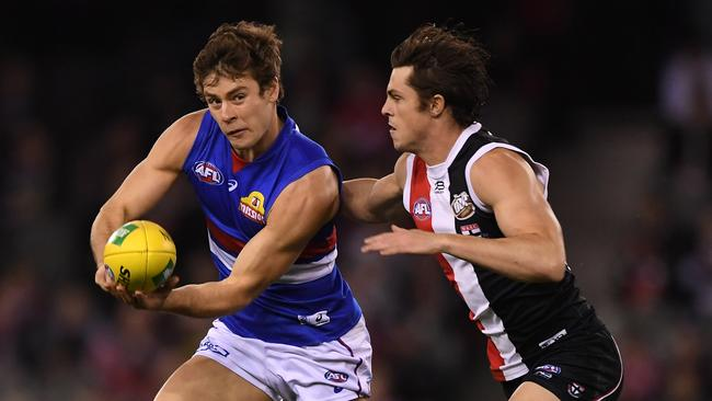 Win or lose, Josh Dunkley of the Bulldogs (left) has been making massive scores in SuperCoach in recent times