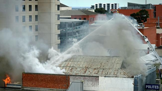 Firefighters battle the blaze near Hindley St. Picture: Roy VanDerVegt.
