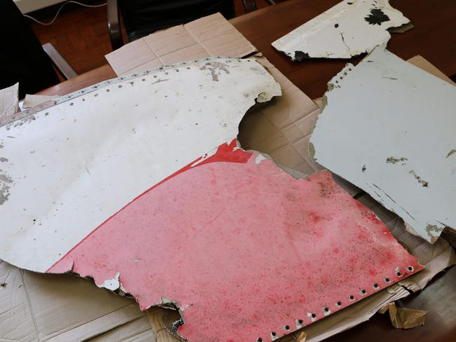 Three pieces of aircraft wreckage — including one a dramatic pink and white — found off the east African coast of Mozambique earlier this month, on display in Maputo on September 5. Picture: Adrien Barber.