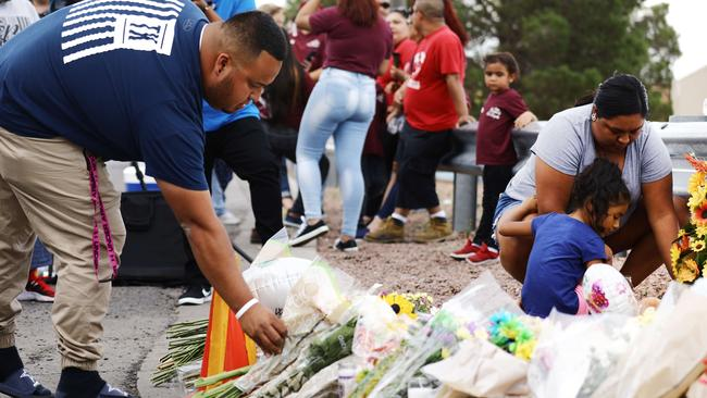 People leave flowers at a makeshift memorial outside Walmart at the scene of a mass shooting in El Paso, Texas. Picture: AFP