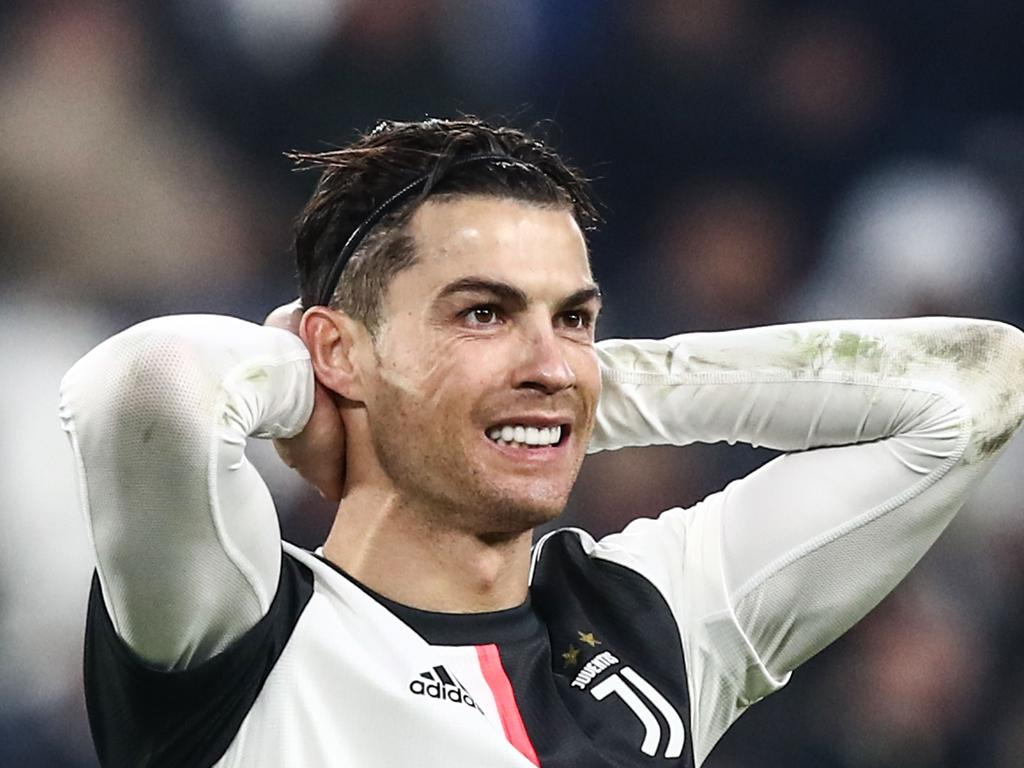Juventus' Portuguese forward Cristiano Ronaldo reacts after missing a goal opportunity during the Italian Serie A football match Juventus vs Udinese on December 15, 2019 at the Juventus Allianz stadium in Turin. (Photo by Isabella BONOTTO / AFP)