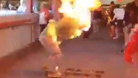 A screenshot from a video showing a pro-Beijing activist after he was set alight. Picture: Supplied