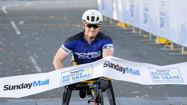 Richard Colman crosses the finish line at the Bridge to Brisbane 2019 at South Bank. Picture: Richard Walker/AAP
