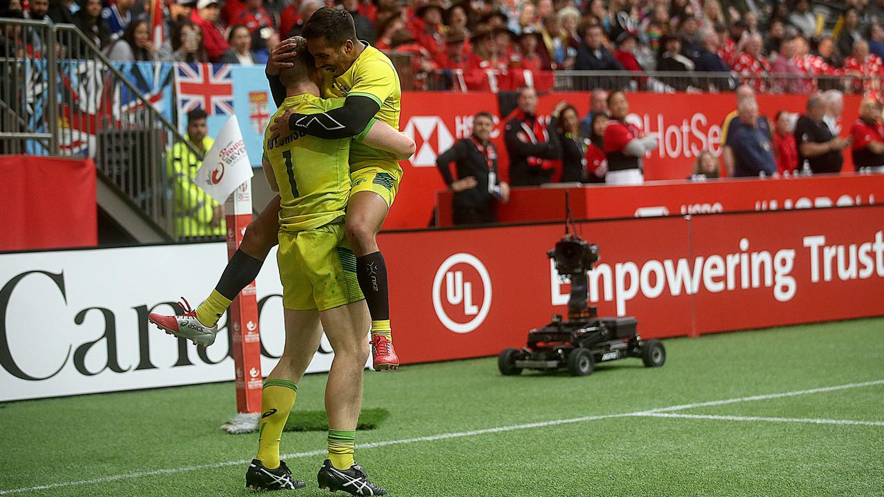 Australia celebrate a try against Canada during their rugby sevens semifinal.