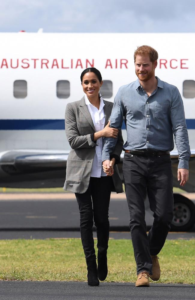 Britain's Prince Harry and his wife Meghan looked a lot more casual yesterday.
