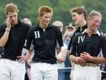 British Prince William (left), Prince Harry (centre) and their father Prince Charles, the Prince of Wales (far right) share a joke with England Polo player Luke Tomlinson at the end of the Calcot Manor Hotel polo cup on June 22, 2003 at Tetbury, Gloucestershire, England. Picture: Getty