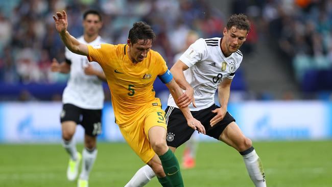 Mark Milligan of Australia and Leon Goretzka of Germany battle for possession during the FIFA Confederations Cup.