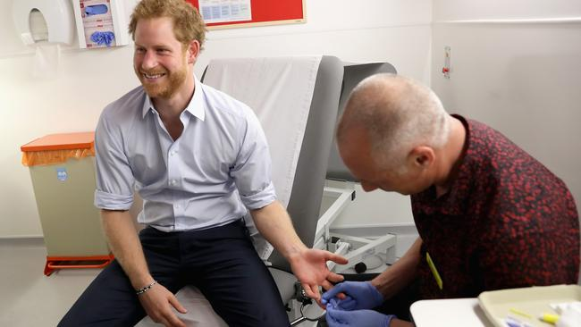 Significant advancements in HIV detection and treatment have been made in recent years — including rapid testing, demonstrated here by Prince Harry. But a cure for the virus has remained elusive. Picture: Getty Images