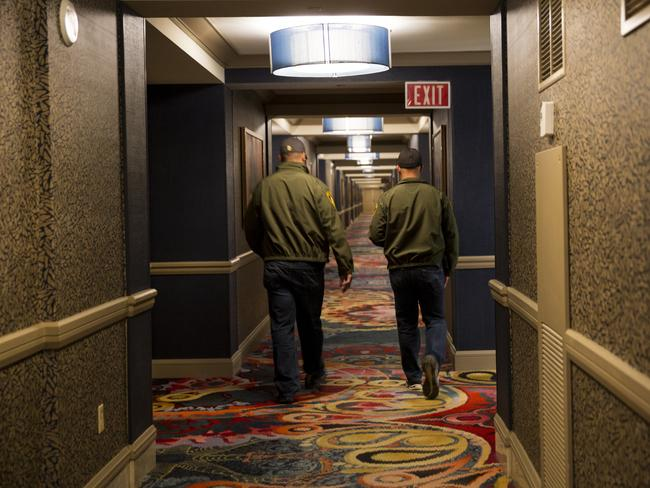 Officers walk down the hallways of the Mandalay Bay Resort and Casino, from where Paddock shot concertgoers. Picture: Bild Exclusive/Polaris/australscope