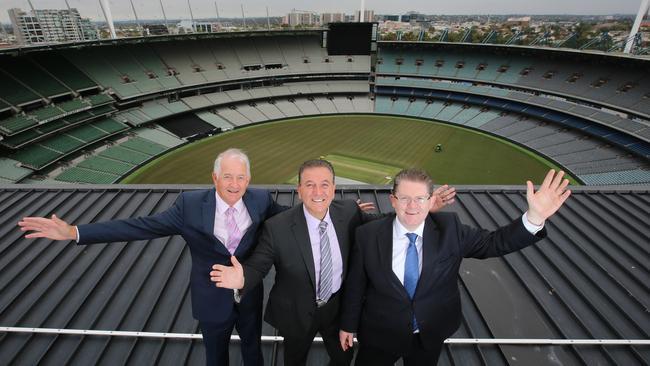 Melbourne Cricket Club chief Stephen Gough, Sports Minister John Eren, and Victorian Senator Scott Ryan on top of the MCG. Picture: Alex Coppel