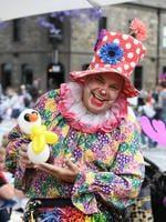 Daisy the clown with a balloon snowman. Photo Naomi Jellicoe