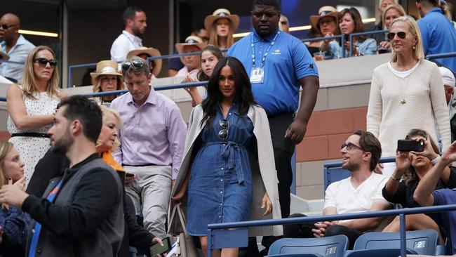 As seen when Meghan dropped by to watch pal Serena Williams play at the US Open, the Duchess of Sussex goes nowhere without an entourage (including security). Picture: Timothy A. Clary/AFP.