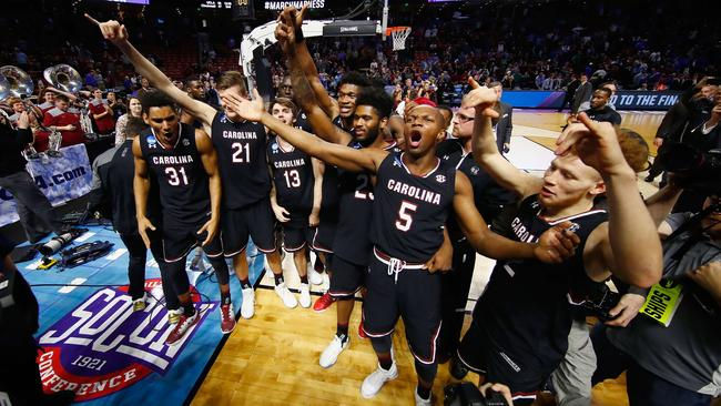 TeMarcus Blanton of the South Carolina Gamecocks celebrates with teammates after defeating the Duke Blue Devils.