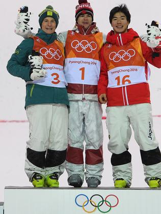 From left to right: Matt Graham of Australia, Mikael Kingsbury of Canada and Daichi Hara of Japan on the podium after winning the silver, gold and bronze medals in the men's moguls final. Picture: AAP