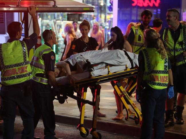 A partygoer is taken to hospital on a stretcher.