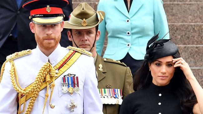 Prince Harry with wife Meghan, Duchess of Sussex arrive for the official opening of the refurbished ANZAC Memorial at Hyde Park in Sydney. Picture: Saeed KHAN / AFP