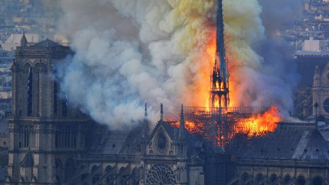 Notre Dame Cathedral burns in front of thousands of people