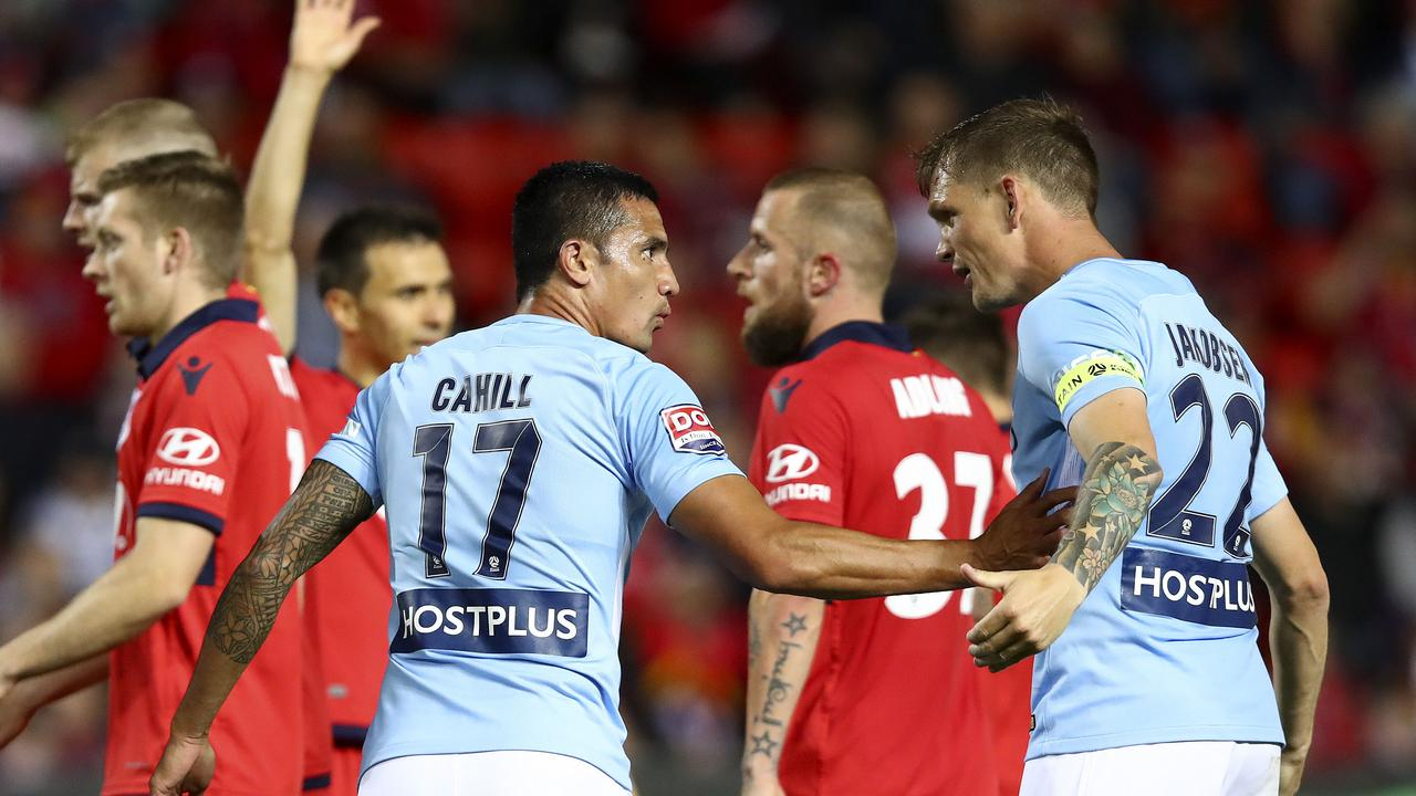 Tim Cahill tries to calm down Michael Jakobsen against Adelaide United.