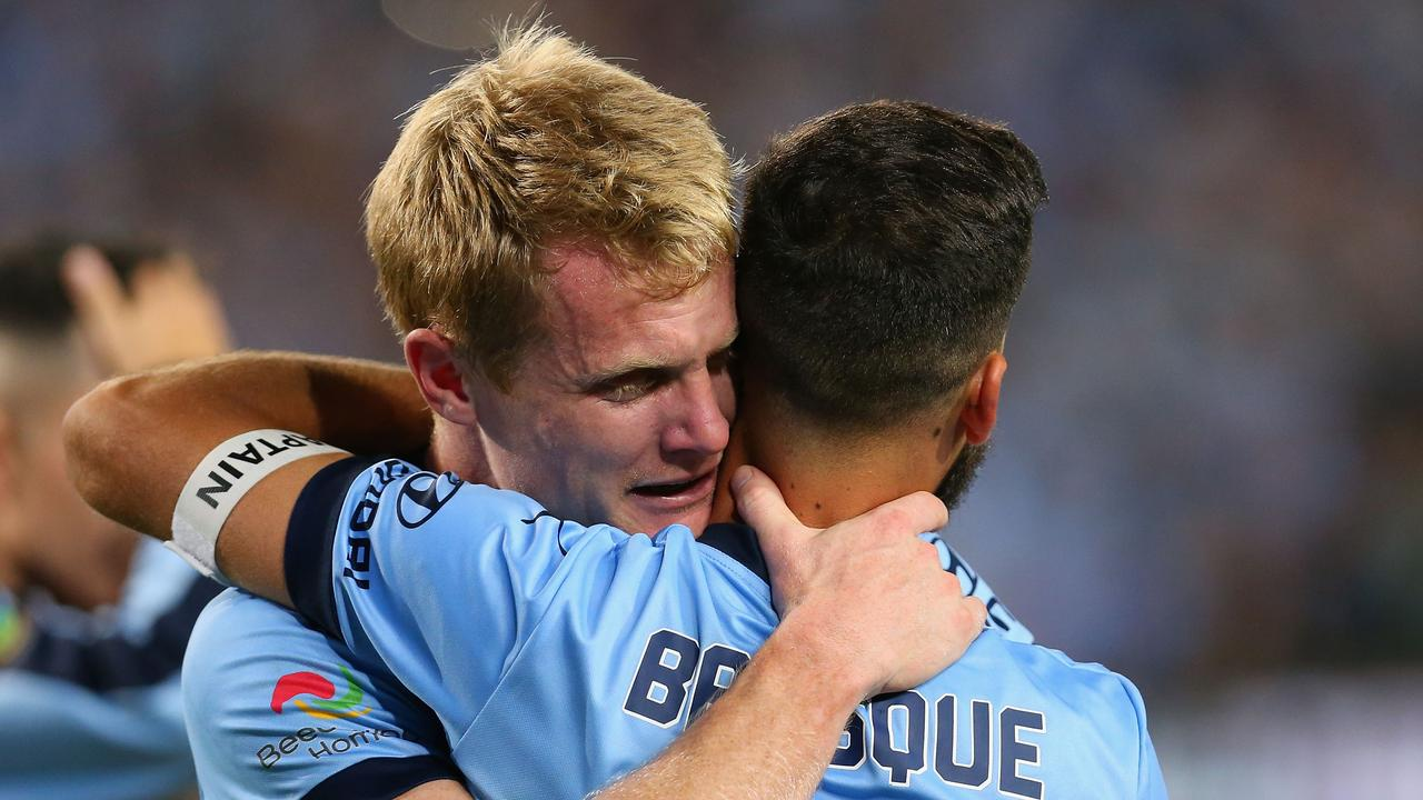 Matt Simon of Sydney embraces Alex Brosque after winning the 2017 A-League Grand Final